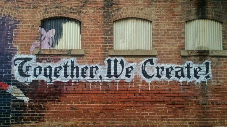 Tiiliseinä, jossa teksti together we create